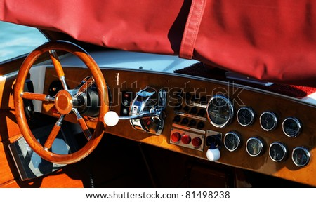 Wooden boat with steering wheel and dashboard