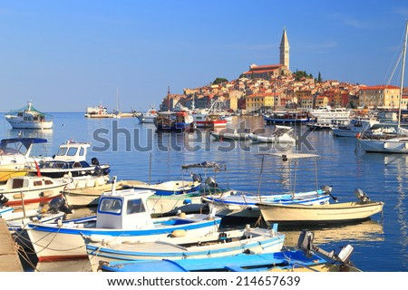 Wooden boats at anchor in the harbor of old Venetian town near the Adriatic sea, Rovinj, Croatia - stock photo