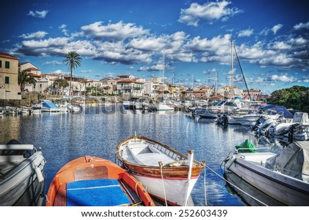 wooden boats in Stintino harbor. Processed for hdr tone mapping effect. - stock photo
