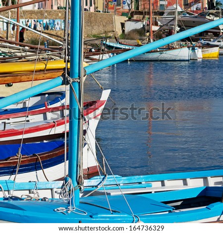 wooden boats in Stintino small harbor