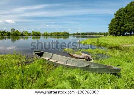 wooden boats on a river bank - stock photo