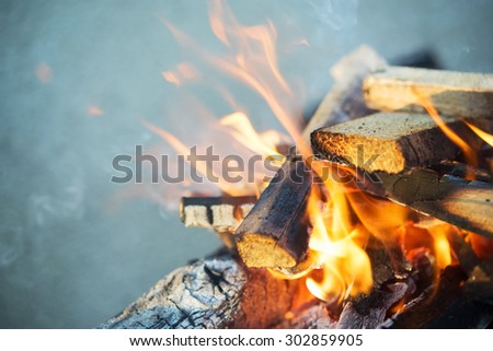 wooden bonfire on bbq as background - stock photo