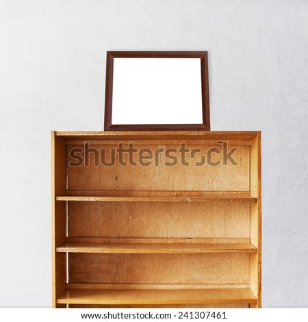 Wooden book Shelf and photo frame on it near the stucco wall background - stock photo