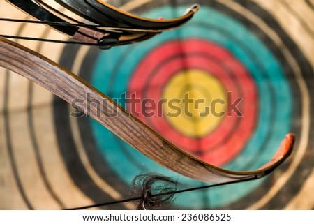 Wooden bow and target - stock photo
