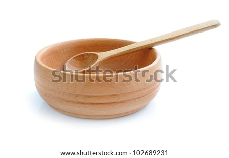 Wooden bowl and spoon isolated in white background