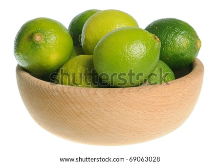 Wooden bowl filled with limes isolated on white background - stock photo