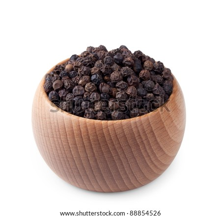 Wooden bowl full of black pepper isolated on white background - stock photo