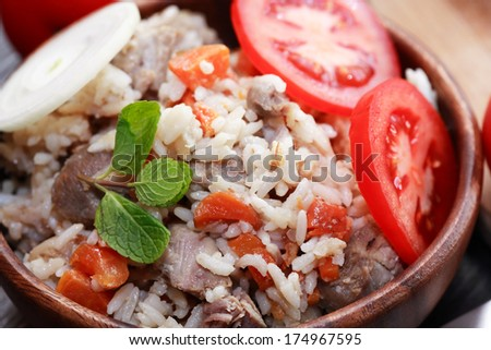 Wooden bowl full of freshness pilaw closeup - stock photo