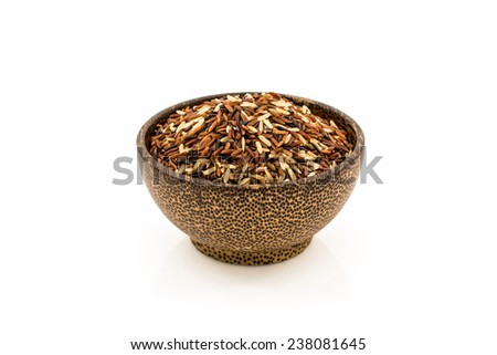 Wooden bowl full of mixed rice