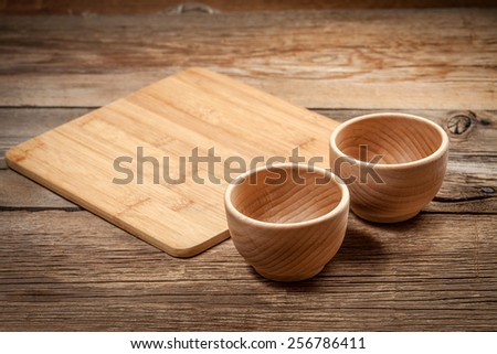 Wooden bowl on a background of old boards. - stock photo
