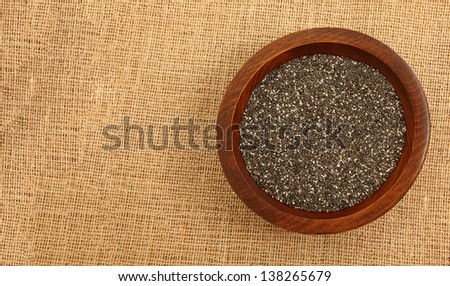 Wooden Bowl With Chia Seeds On Burlap Bag - stock photo