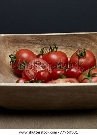 wooden bowl with fresh tomatoes - stock photo