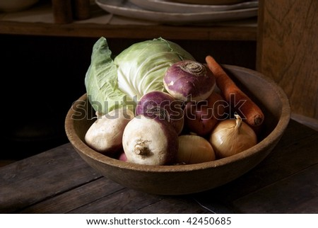Wooden bowl with vegetables - stock photo
