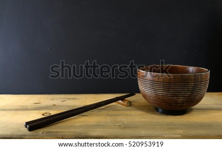 wooden bowls and wooden chopsticks on the table