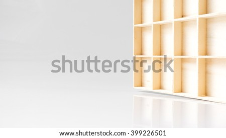 Wooden box compartment or cabinet on white empty background. Isolated on white background. Slightly de-focused and close-up shot. Copy space. - stock photo