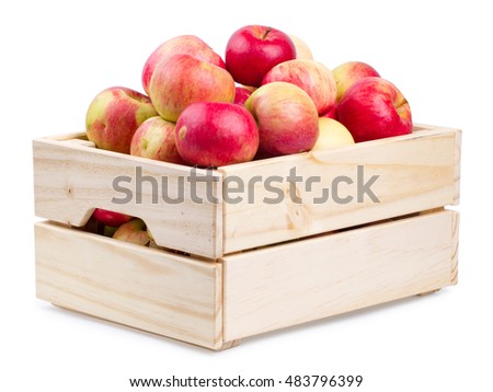 Wooden box full of fresh apples isolated on a white background