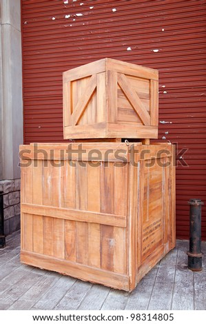 wooden box in front of cargo - stock photo