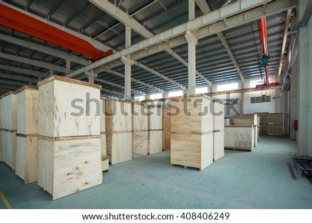 Wooden box in warehouse - stock photo