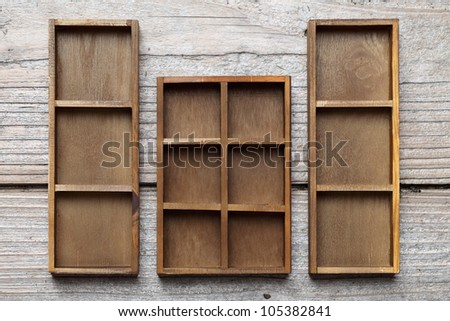 Wooden box tray on table - stock photo