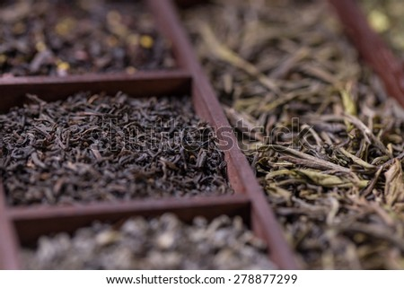 Wooden box with black and green tea - stock photo