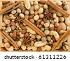 Wooden box with different kinds of nuts, cinnamon and anise. Viewed from above. - stock photo