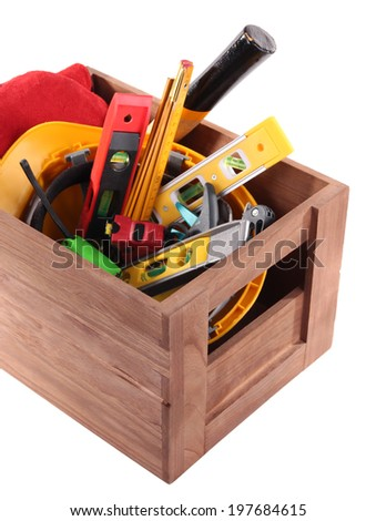 Wooden box with different tools, isolated on white - stock photo