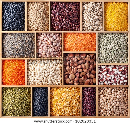 Wooden box with peas, beans and lentils - stock photo