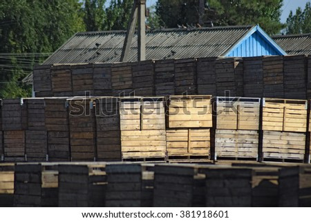 Wooden boxes stacked together. Warehouse empty wooden containers.