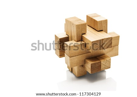 Wooden Brain Teaser on White Background - stock photo
