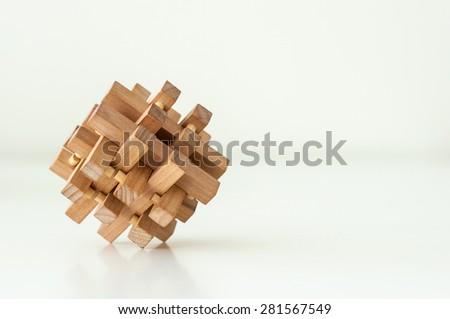 Wooden Brain Teaser on White Background. Logic game - stock photo