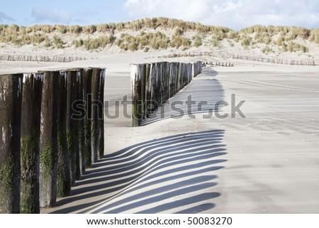 wooden breakwaters - stock photo