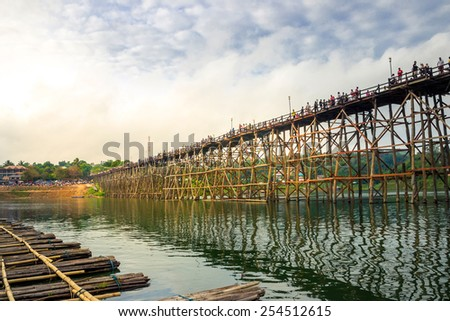 Wooden bridge across river at twilight