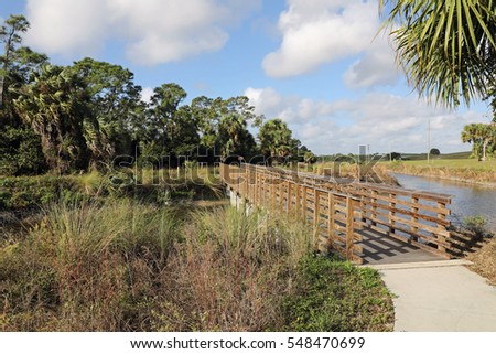 Wooden bridge at the trail head at Winding Waters Natural Area in West Palm Beach, Florida, for the Nature Trail.