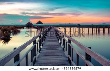 Wooden bridge in Khao Sam Roi Yod National Park, Prachupkhirikhan Province, Thailand. Selective focus. Vintage tone - stock photo