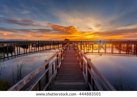 Wooden Bridge in lotus lake on sunset time at Khao Sam Roi Yot National Park, Thailand - stock photo