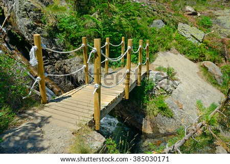 Wooden bridge in the mountains