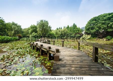 Wooden bridge in the park - stock photo