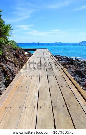 Wooden Bridge on Beautiful turquoise seascape of Koh Lan, Pattaya, Thailand - stock photo