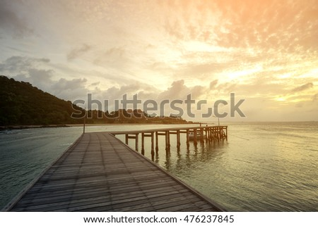 Wooden bridge on sunrise at sea , Khao Laem Ya National Park , Rayong Province  , Thailand.