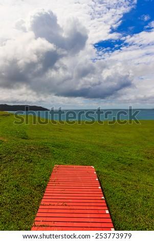 Wooden bridge on the field. Soft focus, shallow dof. Selective focus on the bridge. - stock photo