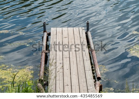 wooden bridge on the river for fishing and recreation