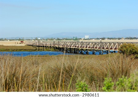 Wooden Bridge Over Tidal Inlet - stock photo