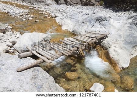 Wooden bridge passing at Samaria gorge of Crete island in Greece - stock photo