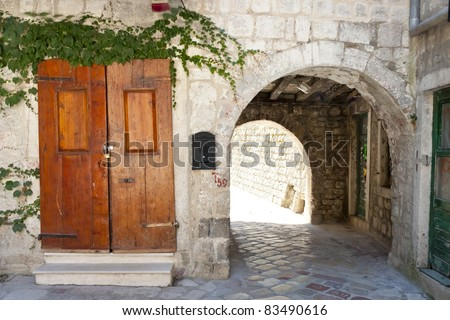 Wooden brown door and ole gate to fortification. Kotor - Montenegro - stock photo