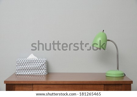 wooden Brown Table with Lamp and Tissue in bedroom - stock photo