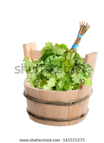 Wooden bucket and oak broom for Russian bath. - stock photo