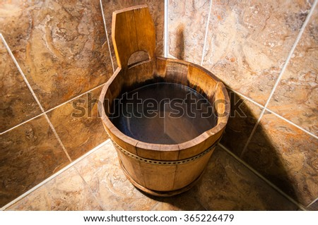 Wooden bucket for the sauna. Accessories and interior of Finnish sauna - stock photo