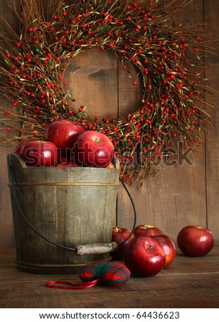 Wooden bucket of apples for the holidays - stock photo