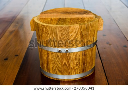 wooden bucket on wood floor - stock photo
