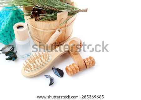 Wooden bucket with ladle for the sauna and stack of clean towels - stock photo